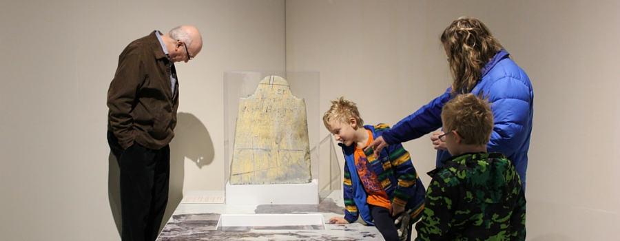 Visitors discovering a travelling exhibition